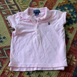 Pink girl's polo shirt.